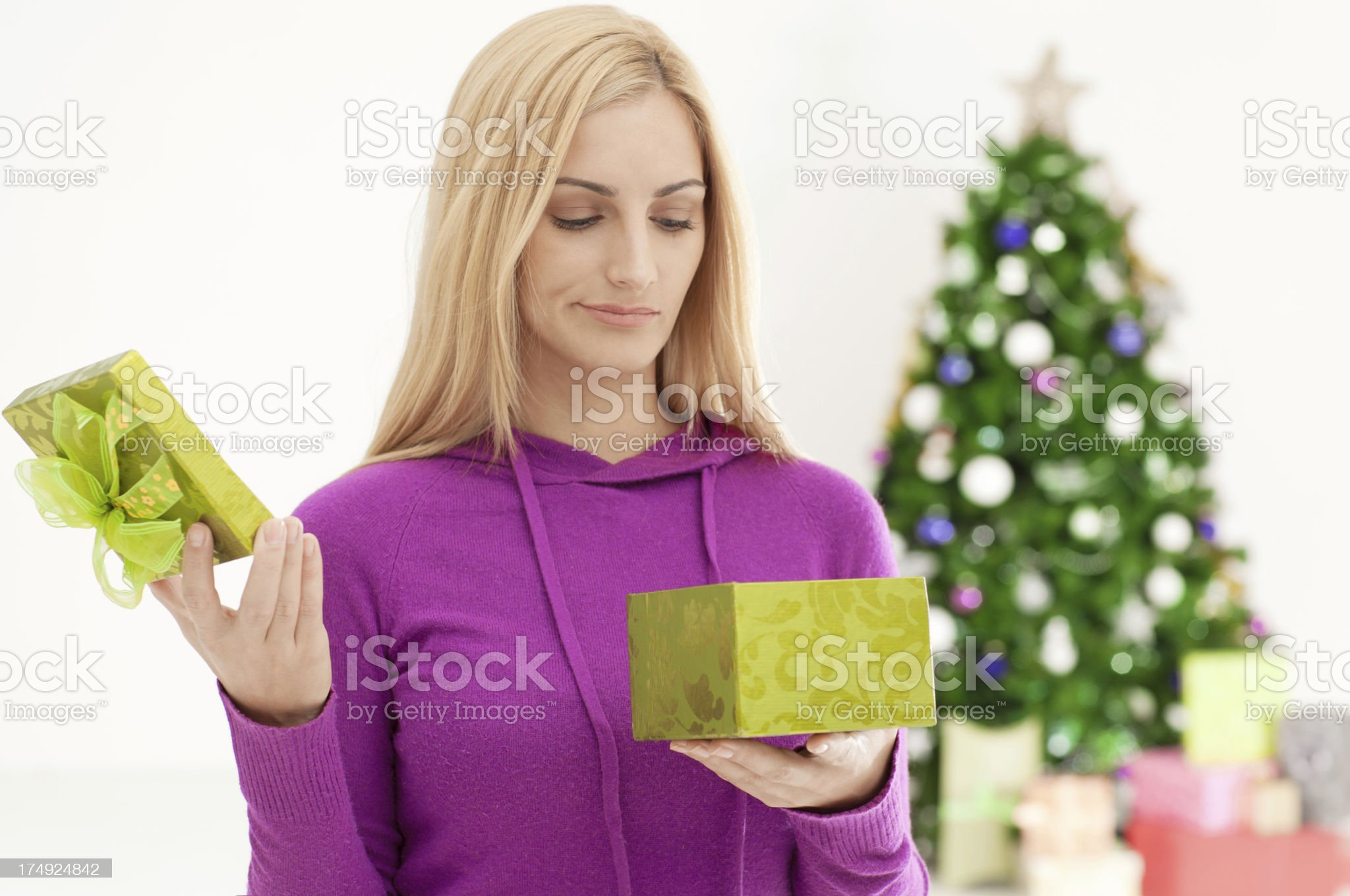 Opening Christmas Present royalty-free stock photo