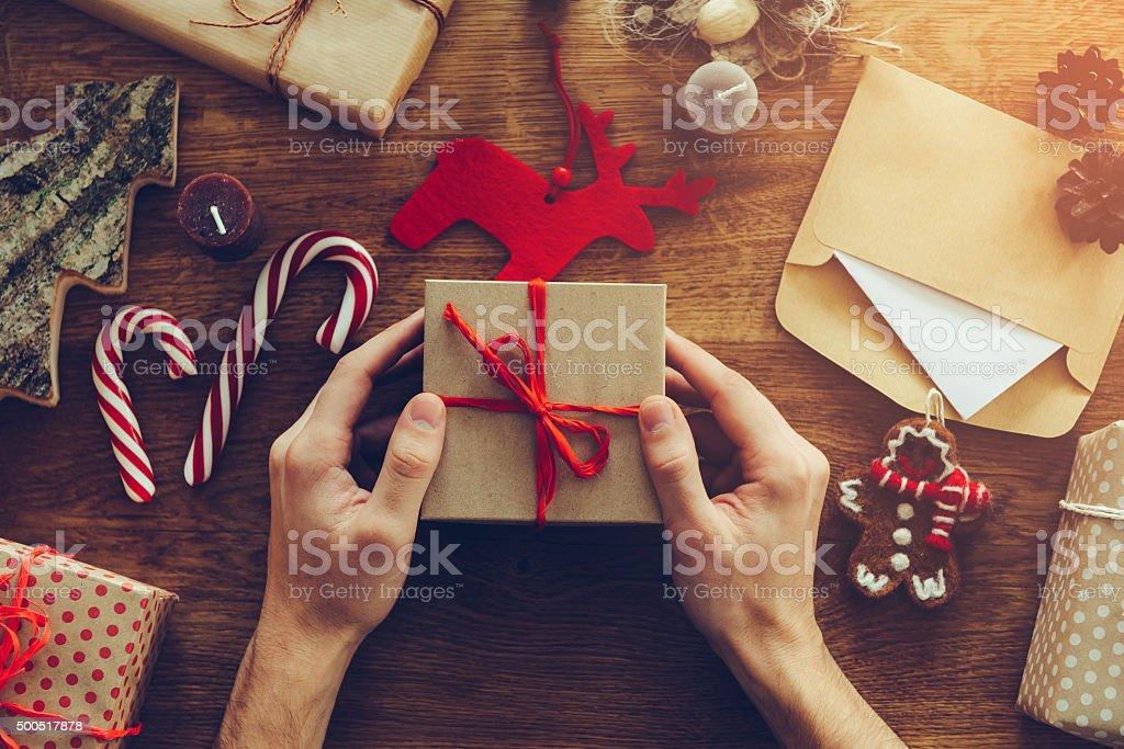 Opening Christmas present. stock photo