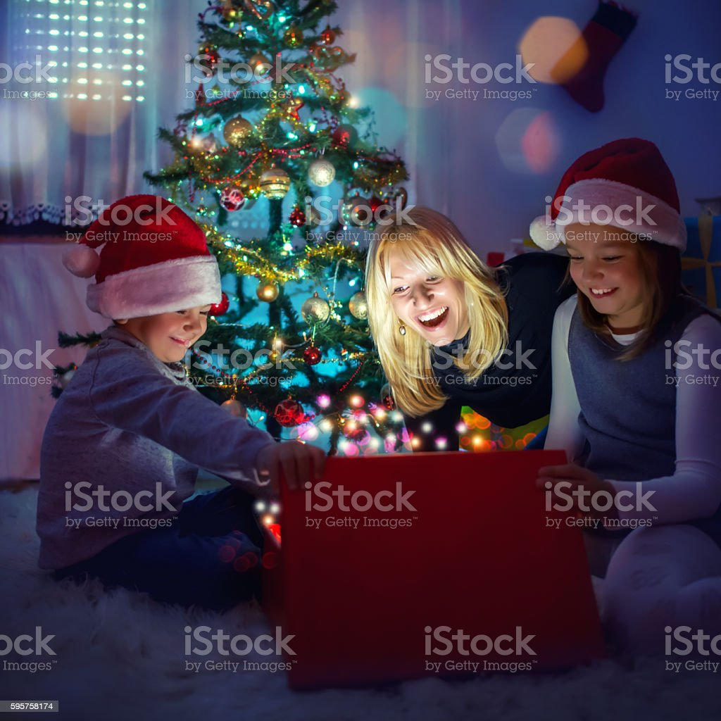 Opening Christmas present stock photo