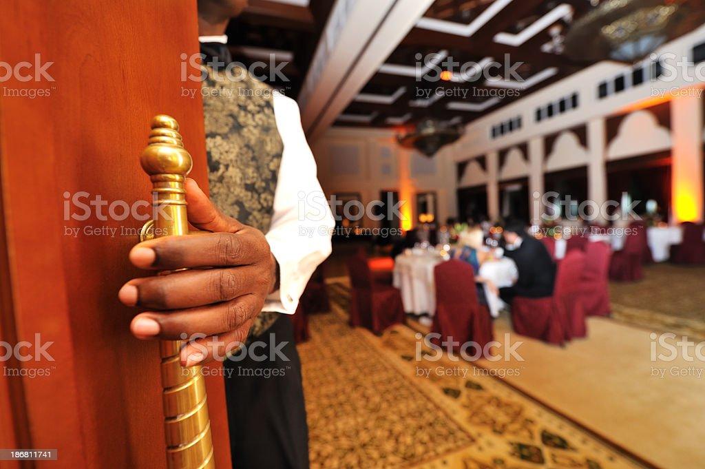opening door to fine dinning stock photo