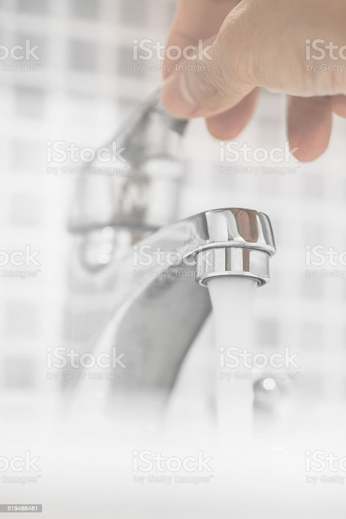 Opening Faucet In The Bathroom royalty-free stock photo