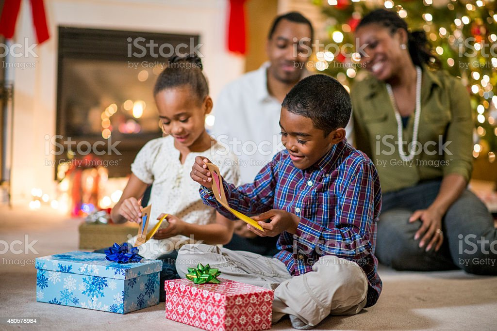Opening Gifts on Christmas Morning stock photo