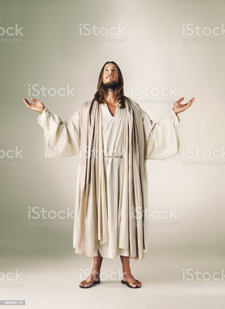 Opening his heart to the divine power of prayer stock photo