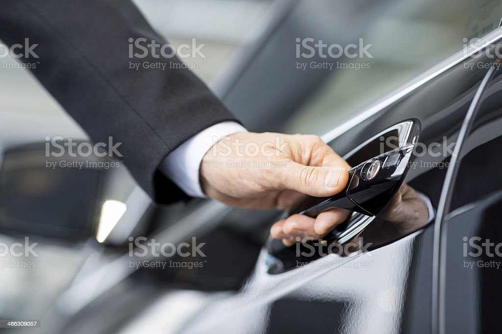 Opening his new car. stock photo
