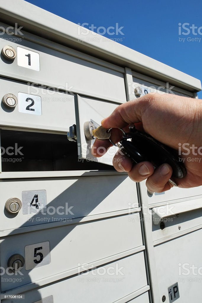 Opening mailbox with a key stock photo