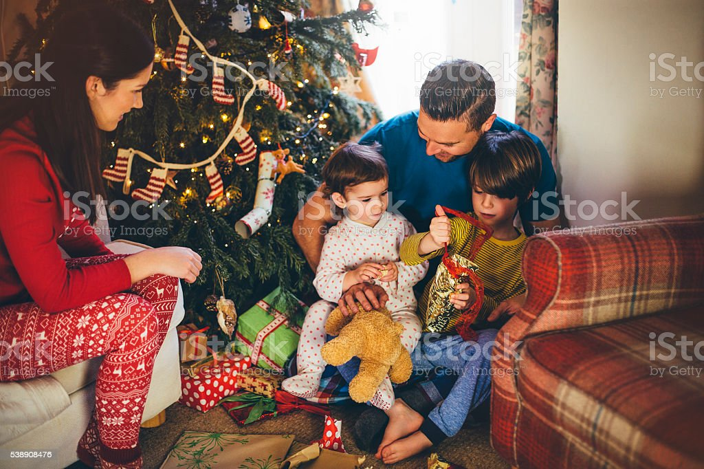 Opening Presents on Christmas Day stock photo
