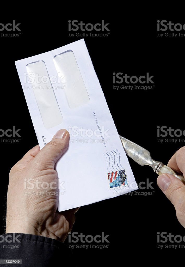 Opening The Letter stock photo