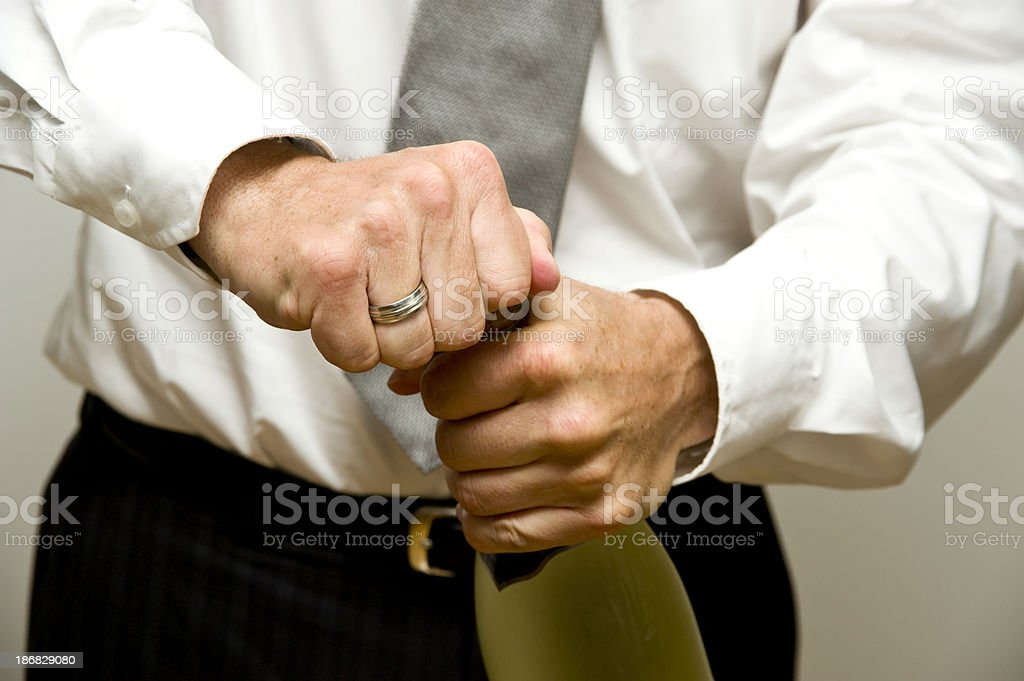 opening the sect or champagner bottle by man royalty-free stock photo