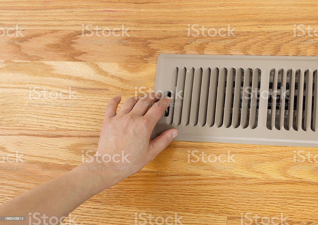 Opening up Floor Vent Heater stock photo