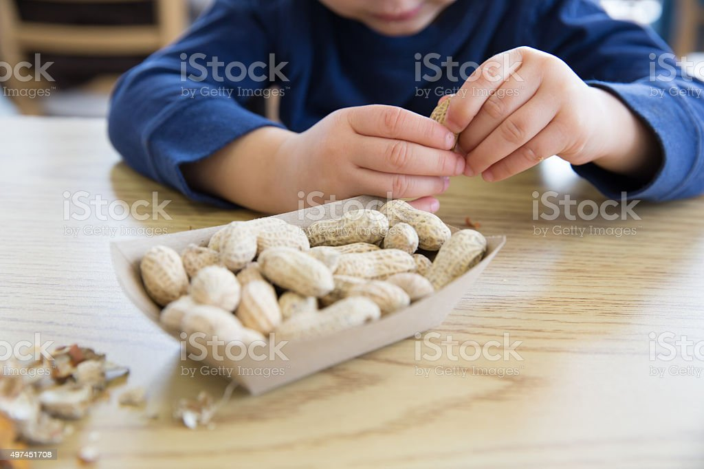 Opening up Peanuts stock photo