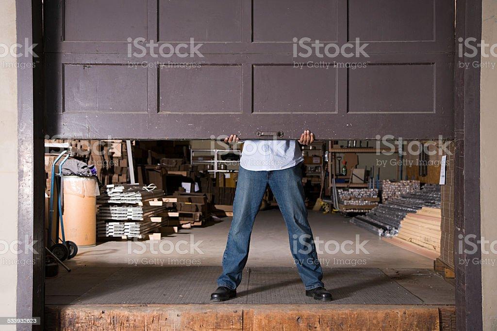 Opening warehouse door stock photo