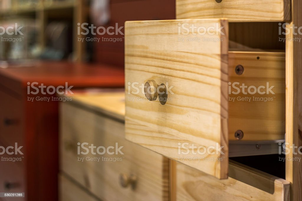 opening wooden drawer stock photo