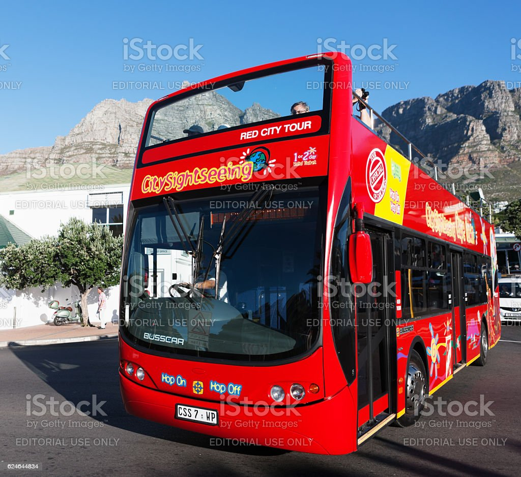 Open-topped, sightseeing tourist bus in Camps Bay, Cape Town stock photo