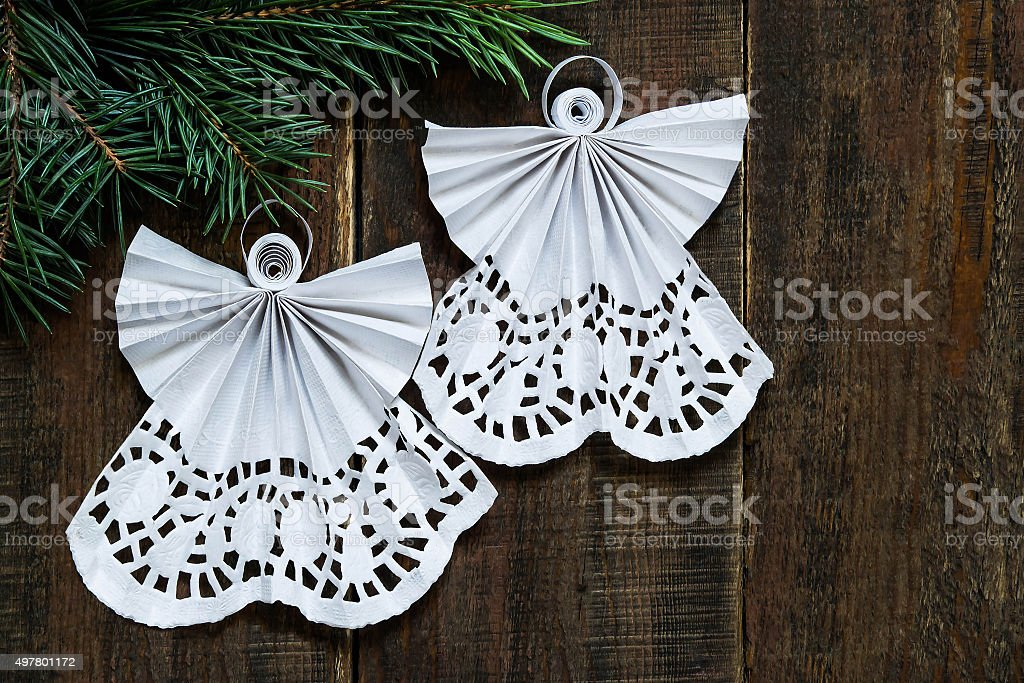 Openwork angels in the art of quilling Christmas decoration stock photo