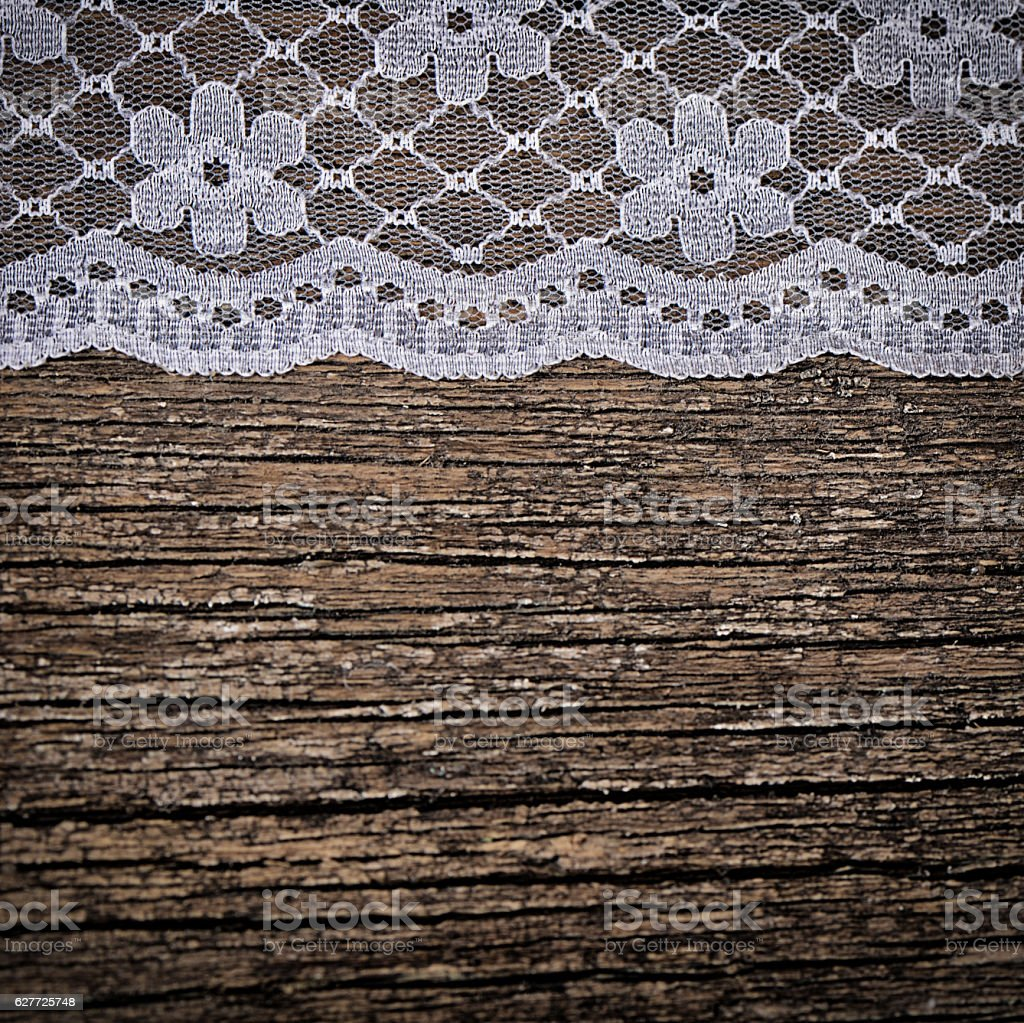 Openwork lace on wooden background stock photo