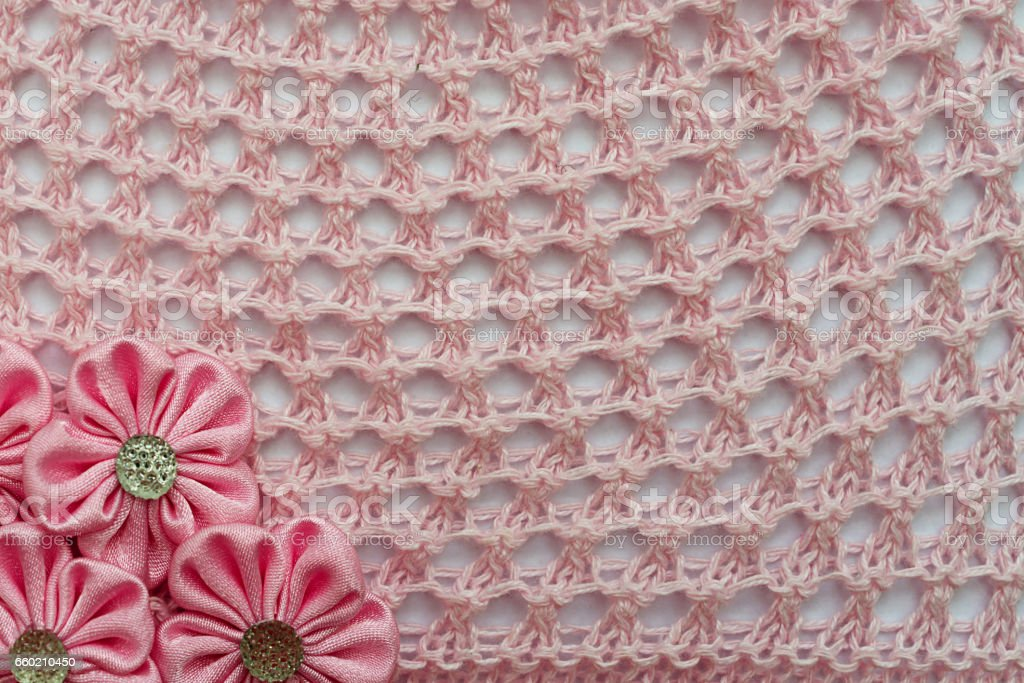 Openwork pattern crochet and flowers. Background for design stock photo