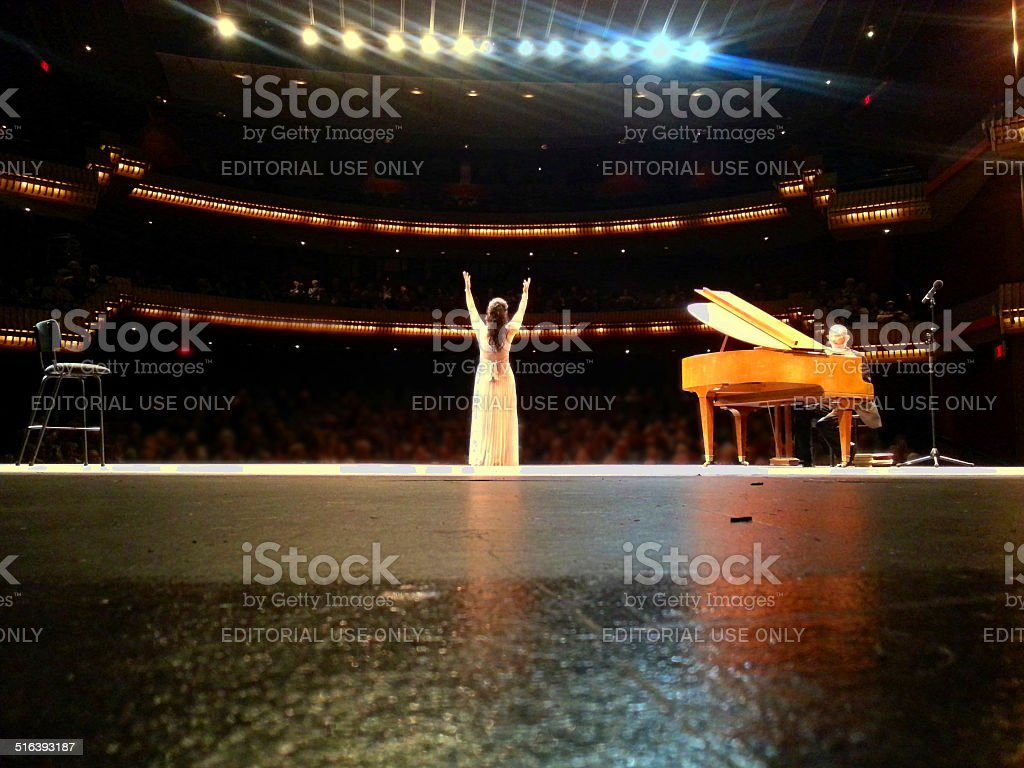 Opera singer performs on stage stock photo