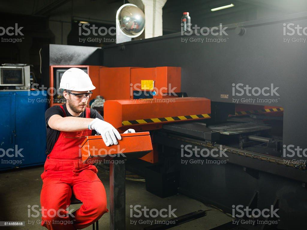 operating a machinery stock photo