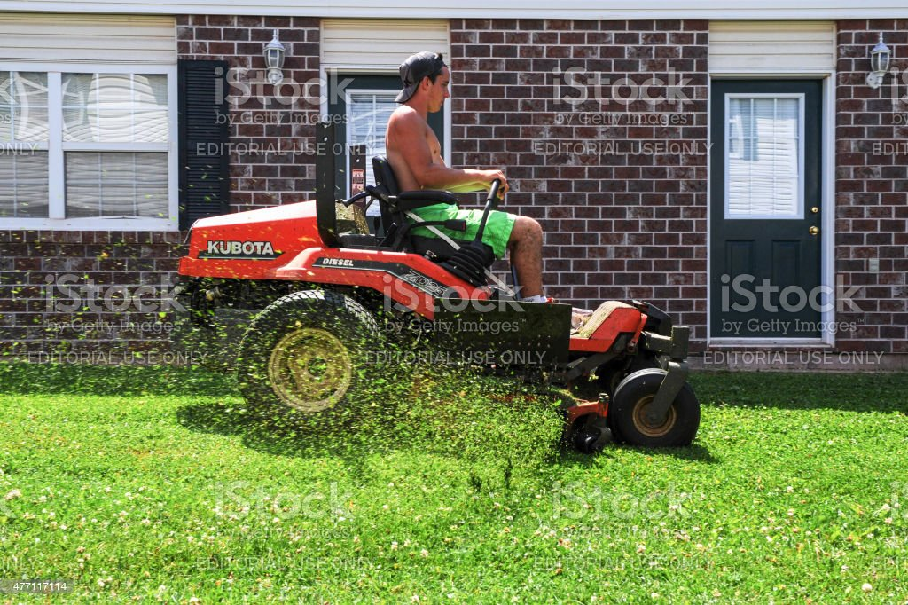 Operating a Ride On Mower stock photo