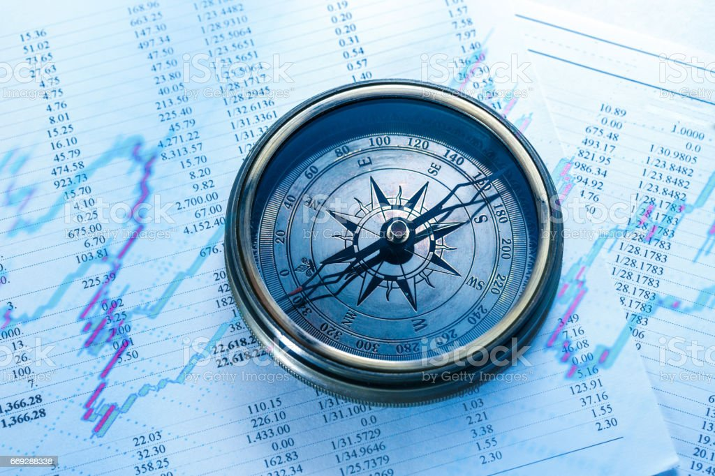Operating budget and vintage compass stock photo