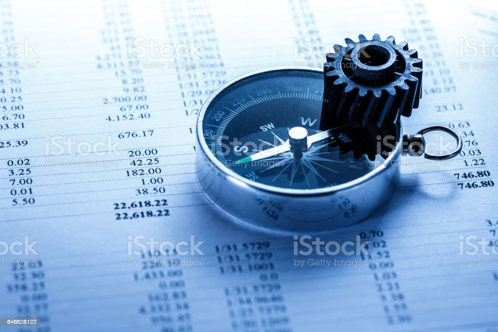 Operating budget, cogwheel and compass stock photo
