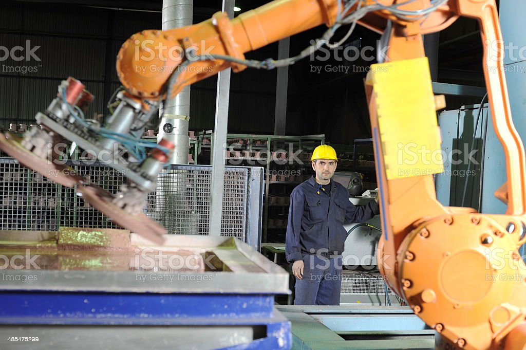 Operating huge industrial mixing machine stock photo
