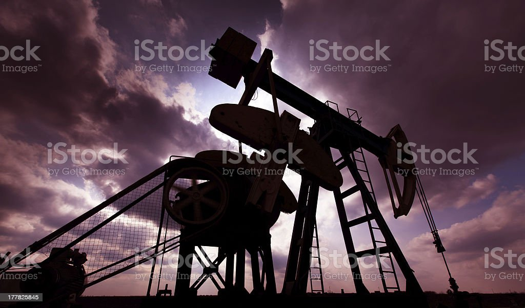 Operating oil well contour profiled on sky royalty-free stock photo