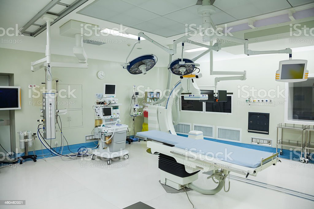 Operating room with sterile surgical equipment in a hospital stock photo