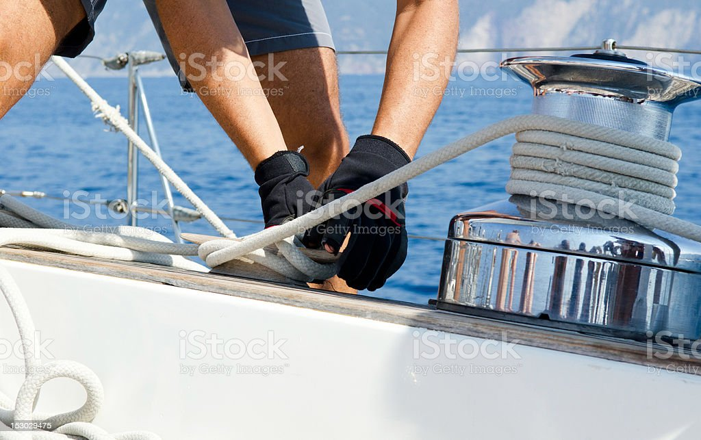 Operating Sail Winch on sailing boat stock photo