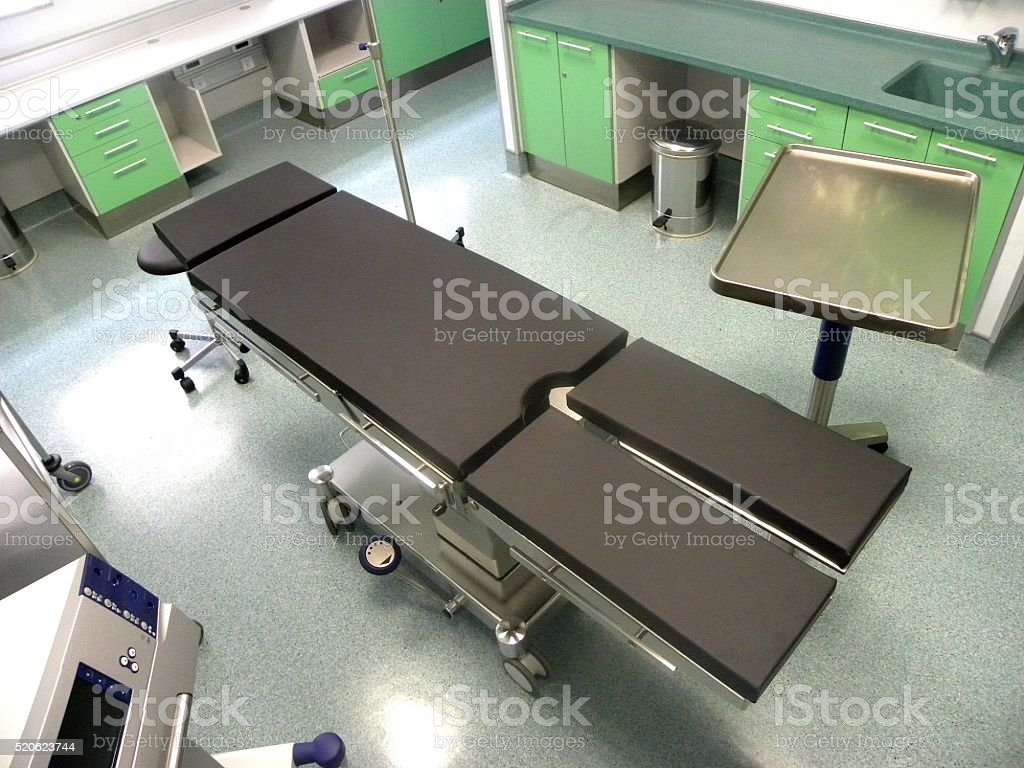 Operating table in surgery intervention room stock photo