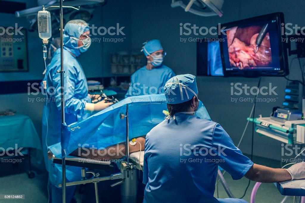 Operating team doing laparoscopic surgery stock photo