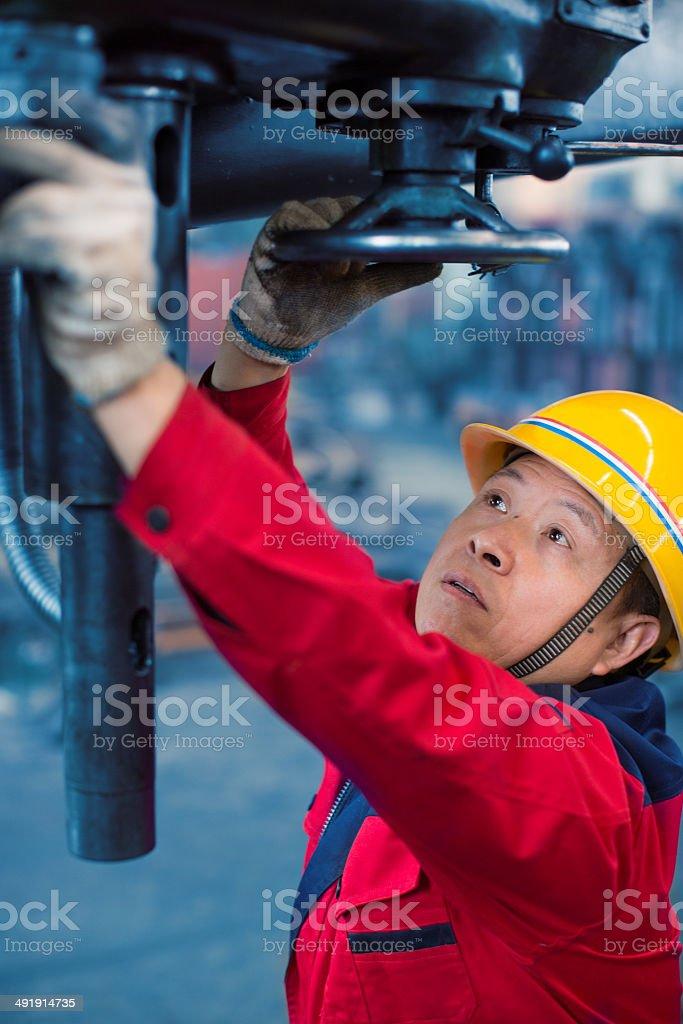 Operating the machine stock photo