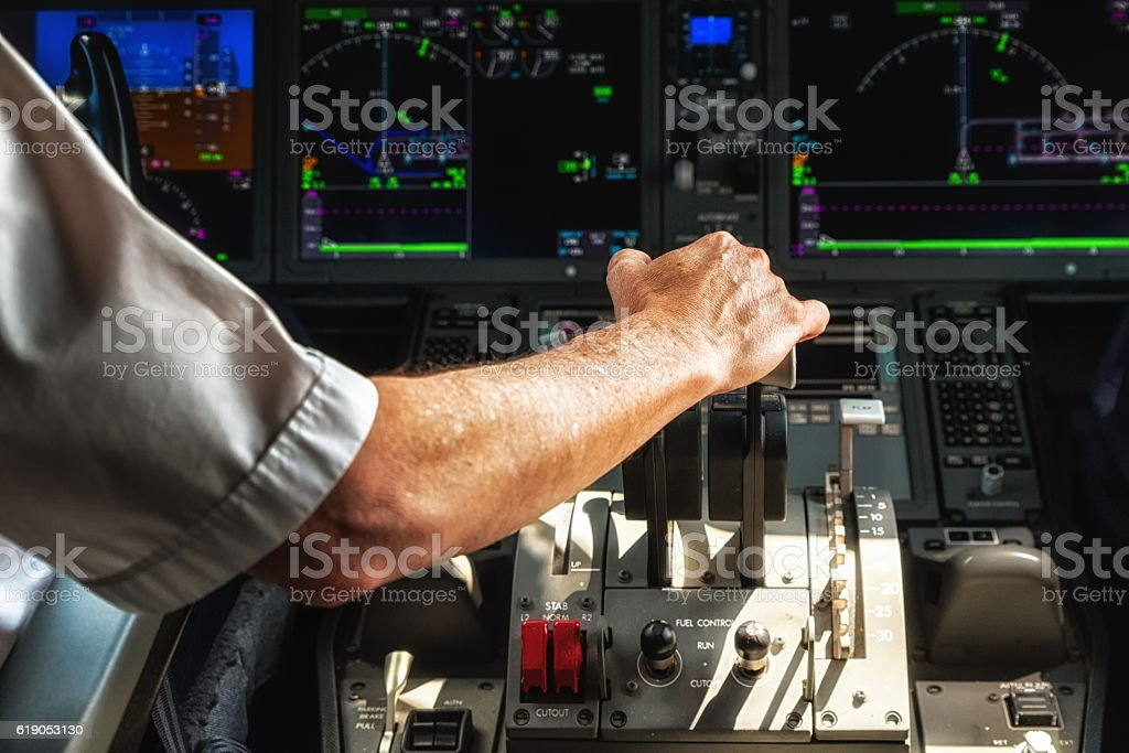 Operating the Throttle for Taking Off stock photo