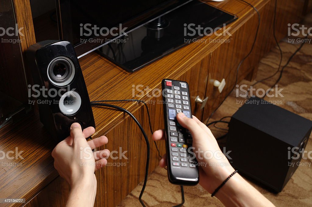Operating the TV stock photo