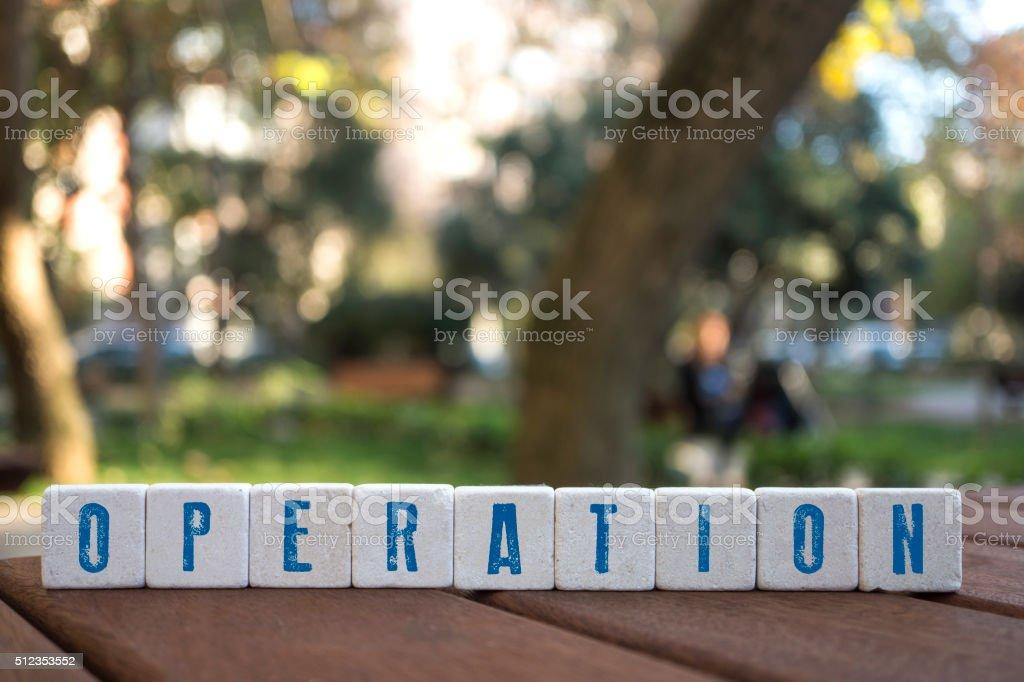 Operation Concept with alphabet blocks stock photo
