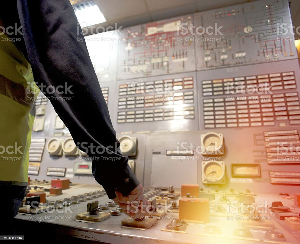 Operator at work place in the system control room stock photo
