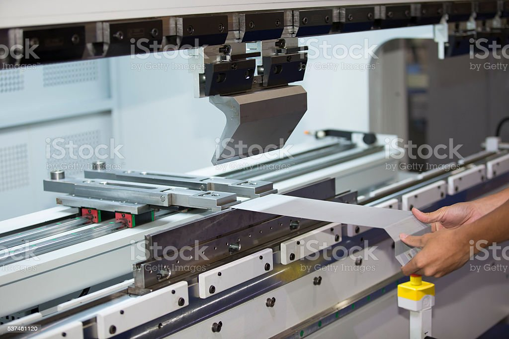 operator bending metal sheet by sheet bending machine stock photo