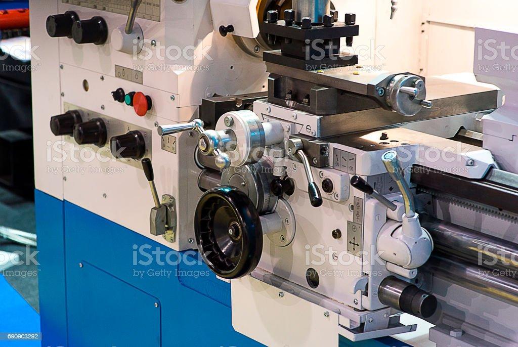 Operator machining automotive part by turning machine, Industry machine background stock photo