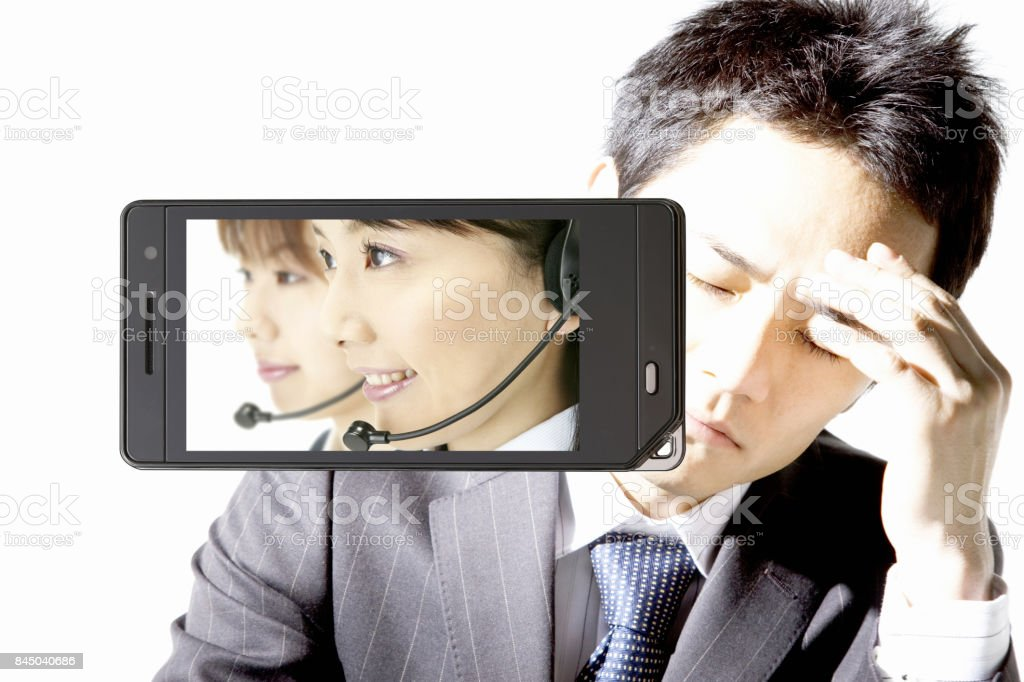 Operator on the mobile screen and businessman stock photo
