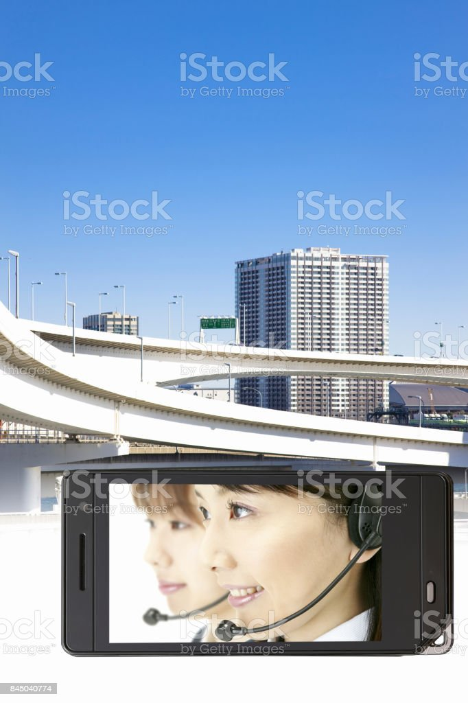 Operator on the mobile screen and high speed road stock photo
