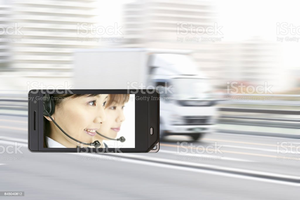 Operator on the mobile screen and track stock photo