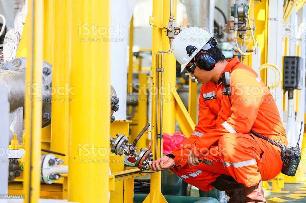operator recording operation of oil and gas process at oil stock photo