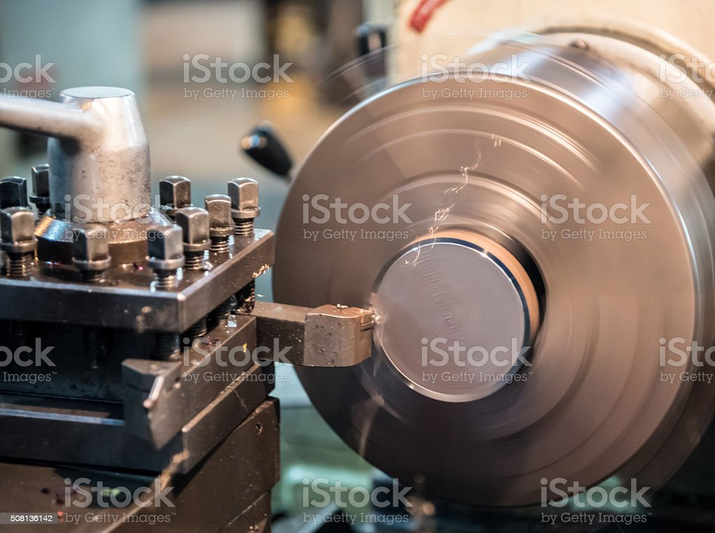 operator turning automotive parts by high precision cnc lathe stock photo