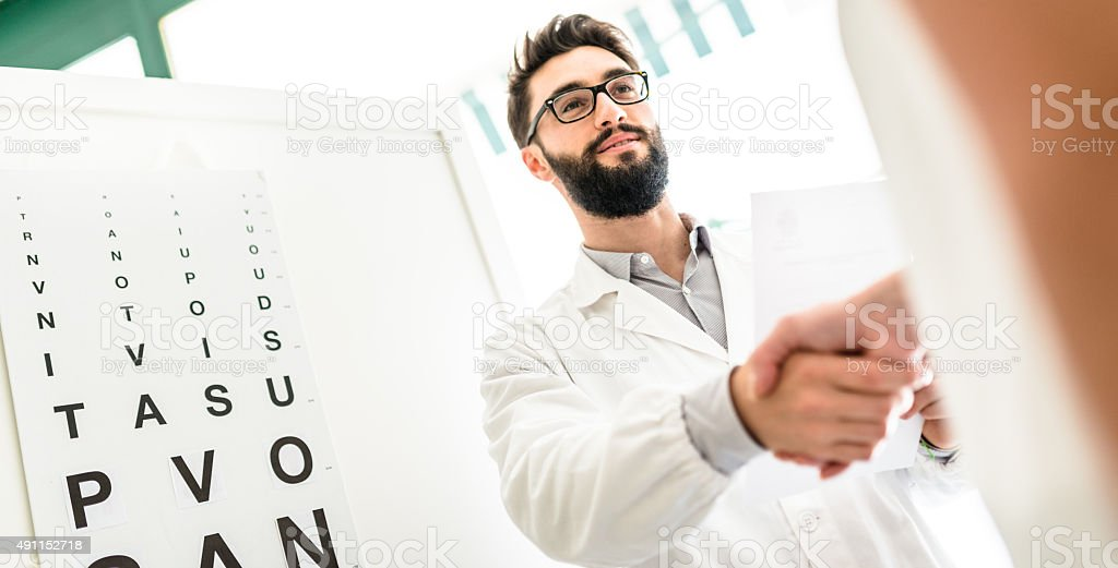 Ophthalmologist doctor meet the patient stock photo