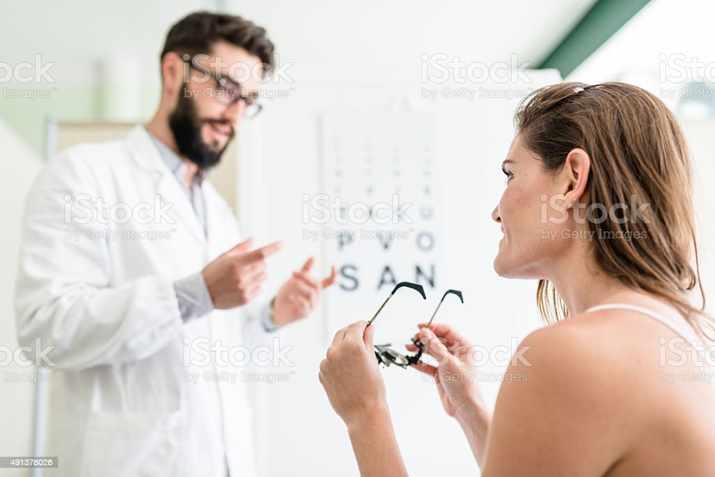 Ophthalmologist doctor talking with the patient stock photo