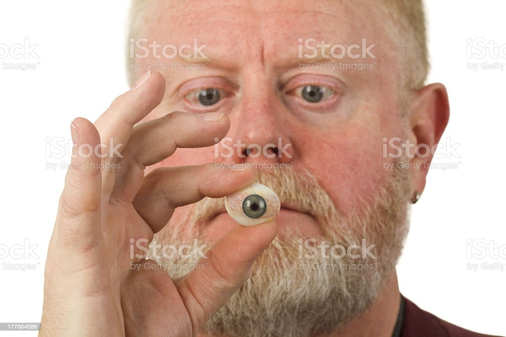 Ophthalmologist holding glass eye royalty-free stock photo