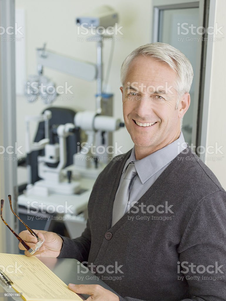 Ophthalmologist in examination room stock photo