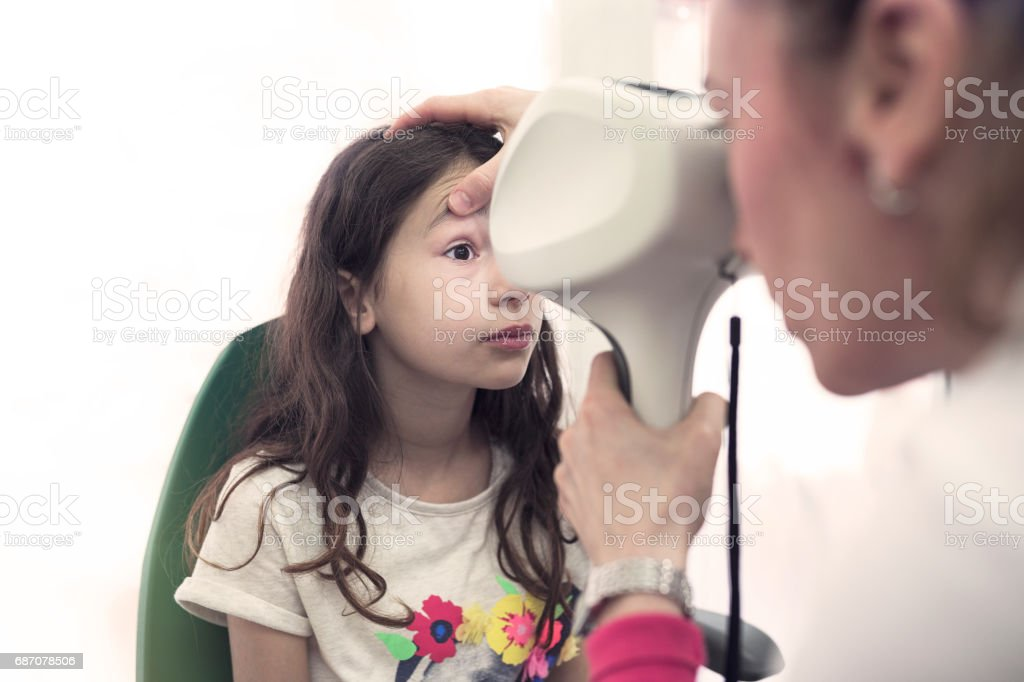 Ophthalmologist measuring intraocular pressure of woman in clinic stock photo