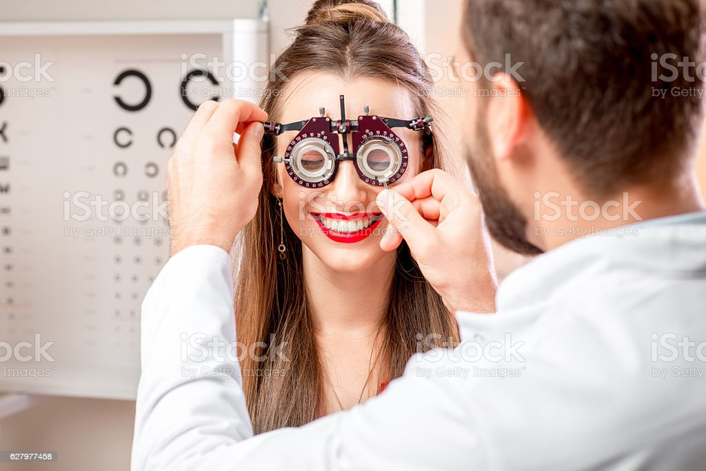 Ophthalmologist with female patient stock photo