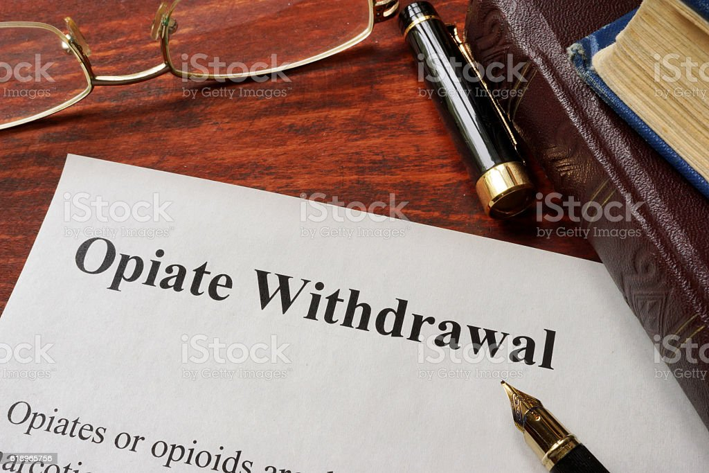 Opiate withdrawal written on a paper. Drugs addiction concept. stock photo